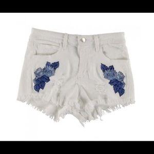White embroidered denim shorts